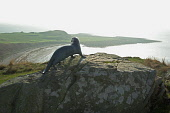 Gavin Maxwell Memorial bronze otter above Monreith Bay, Machars of Wigtownshire, Dumfries and Galloway. Picture Credit: Allan Wright / Scottish Viewpoint Tel: +44 (0) 131 622 7174   Fax: +44 (0) 131 6... Public bronze,clouds,Dumfries & Galloway,Galloway,Gavin Maxwell,golf course,grey,grey sky,historical,horizon,Machars,memorial,Monreith Bay,monument,nature,otter,penny wheatly,rocks,scotland,sculpture,sea,sky