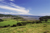 Kippford and Rough Firth from by Glenisle near Palnackie, Dumfries and Galloway. Picture Credit: Allan Wright / Scottish Viewpoint Tel: +44 (0) 131 622 7174   Fax: +44 (0) 131 622 7175 E-Mail : info@s... Public agricultural,beach,blue,blue sky,boat,boats,bright,buildings,bushes,cattle,clear,clouds,coast,colvend,Colvend Coast,cottage,countryside,cows,cumbria,dinghy,dry,Dumfries & Galloway,England,estuary,farm