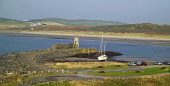 Port Logan Bay, Rhinns of Galloway, Dumfries and Galloway. Picture Credit: Allan Wright / Scottish Viewpoint Tel: +44 (0) 131 622 7174   Fax: +44 (0) 131 622 7175 E-Mail : info@scottishviewpoint.com T... Public agricultural,bay,beach,bench,boat,bright,cars,cattle,coast,cows,dog,dry,Dumfries & Galloway,farm animals,farming,field,forest,Galloway,grass,hills,houses,lighthouse,men,moorings,overcast,path,Port Log