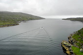 A small fishing boat heads out towards The Minch from the Sound of Scalpay, Outer Hebrides. Picture Credit: Chris Robson / Scottish Viewpoint Tel: +44 (0) 131 622 7174   Fax: +44 (0) 131 622 7175 E-Ma... Public cloudy,western isles,water,summer,overcast,island,industry,harris,coastal,coast