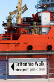 Normand Pioneer vessel in the Port of Leith - which was used in the failed rescue attempt after the Russian Kursk submarine disaster of 2000, with the Britannia walk sign showing the way the Royal Yac... Public Normand,Pioneer,multifunctional,offshore,support,vessel,port,of,leith,dockside,dock,edinburgh,Ulstein,Ship,Technology,pioneering,design,kursk,rescue,LR5,maritime,heavy,industry,vertical,portrait,forma