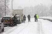 Cars stuck in the snow on the closed A80 during adverse weather conditions, Muirhead, North Lanarkshire. Picture Credit: Garry McHarg / Scottish Viewpoint Tel: +44 (0) 131 622 7174   Fax: +44 (0) 131... Public winter,sunny,cold,freezing,transport,lorry,snowing,people
