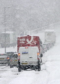Cars stuck in the snow on the closed A80 during adverse weather conditions, Muirhead, North Lanarkshire. Picture Credit: Garry McHarg / Scottish Viewpoint Tel: +44 (0) 131 622 7174   Fax: +44 (0) 131... Public winter,sunny,cold,freezing,transport,lorry,snowing