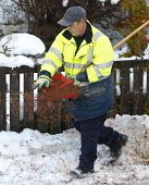 A council workman clears and grits the pavement during adverse weather conditions, Crowwood, North Lanarkshire. Picture Credit: Garry McHarg / Scottish Viewpoint Tel: +44 (0) 131 622 7174   Fax: +44 (... Public winter,cold,shovel,shovelling,snow