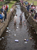 The Annual Ceres Raft Race held during the Ceres Highland Games, Fife. Picture Credit: Ian Paterson / Scottish Viewpoint Tel: +44 (0) 131 622 7174   Fax: +44 (0) 131 622 7175 E-Mail : info@scottishvie... Public, NMR boats,burn,children,community,competition,event,family,float,floating,fun,game,games,green,kids,summer,tradition,village,people