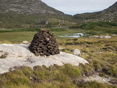 Cut Peats Stacked for Drying on the Isle of Harris in the Outer Hebrides Picture Credit: Ian Paterson / Scottish Viewpoint Tel: +44 (0) 131 622 7174   Fax: +44 (0) 131 622 7175 E-Mail : info@scottishv... Public Harris,Hebrides,Scotland,Scottish,bricks,cut,dry,drying,fuel,isle,isles,landscape,local,of,out,peat,peats,pile,resource,stack,tradition,traditional,western