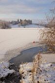Looking across frozen Loch to Linlithgow Palace, Scotland, December, 2010 Pic: D. Barnes / Scottish Viewpoint  Tel: +44 (0) 131 622 7174  Fax: +44 (0) 131 622 7175  E-Mail : info@scottishviewpoint.com... Public Vertical,Linlithgow,palace,snow,snowscape,ice,loch,Peel,frozen,winter,sunny,west,lothian,Scotland,UK,United,Kingdom,historic,Travel,heritage,tourist,Attraction,Tourism,Visitor