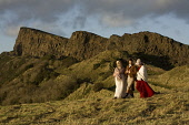 A tour guide dressed as Robert Burns poses in character with two young ladies during a romantic walk. Pic: Gary Doak / Scottish Viewpoint  Tel: +44 (0) 131 622 7174  Fax: +44 (0) 131 622 7175  E-Mail... Public Rabbie,poet,bard,literary,costume,arthurs seat,edinburgh