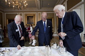 HRH The Duke of Edinburgh at The Royal Society of Edinburgh (Scotland's National Academy of Science and Letters) pours the tea for himself along with leading Scottish chemist, Sir Fraser Stoddart (lef... Public interior,event,royal,ceremony,royalty