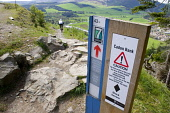 Cadon Bank - Mountain Biking track sign above the town of Innerleithen, Scottish Borders. Picture Credit : Jason Baxter / Scottish Viewpoint  Tel: +44 (0) 131 622 7174  Fax: +44 (0) 131 622 7175  E-Ma... Public spring,sunny,hills,valley,tweed,countryside,activity,cycling,black route,grade,severe,danger,information,instructions,stanes,seven,7,7stanes,trail,trails