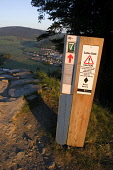 Cadon Bank - Mountain Biking track sign above the town of Innerleithen, Scottish Borders. Picture Credit : Jason Baxter / Scottish Viewpoint  Tel: +44 (0) 131 622 7174  Fax: +44 (0) 131 622 7175  E-Ma... Public spring,sunny,hills,valley,tweed,countryside,activity,cycling,black route,grade,severe,danger,information,instructions,stanes,seven,7,7stanes,trail,trails,evening,sunlight,atmospheric