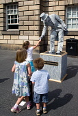Children shake hands with Lord Livingstone, a street entertainer on the Royal Mile during the Edinburgh Festival. Picture Credit : Ross Graham / Scottish Viewpoint  Tel: +44 (0) 131 622 7174  Fax: +44... Public, NMR mime,summer,sunny,theatre,living statue,fringe,old town