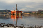 Evening light falls on an oil rig under construction at Nigg Bay in the Cromarty Firth, Highland Picture Credit : Ross Graham / Scottish Viewpoint  Tel: +44 (0) 131 622 7174  Fax: +44 (0) 131 622 7175... Public technology,petrochemical,engineering,platform,highlands,reflection