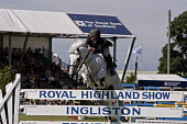 Show jumping at the Royal Highland Show, Ingliston, Edinburgh Picture Credit : Gary Doak / Scottish Viewpoint  Tel: +44 (0) 131 622 7174  Fax: +44 (0) 131 622 7175  E-Mail : info@scottishviewpoint.com... Public horse,equestrian,competition,jump,showground,summer,sunny,event,attraction