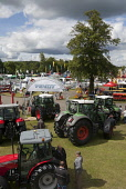 Farm machinery on display on the opening day of the 2011 Royal Highland Show at Ingliston, Edinburgh. Picture Credit : Gary Doak / Scottish Viewpoint  Tel: +44 (0) 131 622 7174  Fax: +44 (0) 131 622 7... Public red,combine,harvester,agricultural,agriculture,showground,display,Massey,Ferguson,farming,farmers,sunny,summer,event,attraction,people