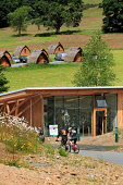 The Glentress Peel facility - gateway to the Tweed Valley Forest Park near Peebles catering for 300,000 visitors a year and includes a cafe, bike shop, bike hire, changing rooms, showers and toilets,... Public 2011,tourism,activity,modern,cycling,cyclists,bikes,pods,accommodation,sunny,summer