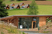 The Glentress Peel facility - gateway to the Tweed Valley Forest Park near Peebles catering for 300,000 visitors a year and includes a cafe, bike shop, bike hire, changing rooms, showers and toilets,... Public 2011,tourism,activity,modern,cycling,pods,accommodation,sunny,summer