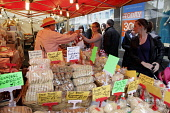 Farmers Market in Kilmarnock town centre, Ayrshire. Picture Credit: Iain McLean / Scottish Viewpoint Tel: +44 (0) 131 622 7174   Fax: +44 (0) 131 622 7175 E-Mail : info@scottishviewpoint.com This phot... Public 2011,event,people,shopping,shoppers,retail,food,produce,biscuits,baking,shortbread