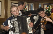 Orkney Folk Festival STROMNESS ORKNEY Musicians playing Accordion fiddles Royal Hotel lounge bar Picture Credit: Doug Houghton / Scottish Viewpoint Tel: +44 (0) 131 622 7174   Fax: +44 (0) 131 622 717... Public orkney,folk,festival,stromness,accordion,fiddles,scotland,scottish,music,violin,violins,violinist,violinists,fiddle,fiddler,fiddlers,bow,bows,strings,string,tradition,heritage,traditional,culture,cult