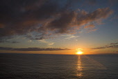 Sunset YESNABY ORKNEY Grey Orange clouds sunset on horizon over Atlantic Ocean Picture Credit: Doug Houghton / Scottish Viewpoint Tel: +44 (0) 131 622 7174   Fax: +44 (0) 131 622 7175 E-Mail : info@sc... Public sunset,atlantic,ocean,dramatic,skyscape,sun,dusk,scotland,scottish,isolation,peace,tranquil,fresh,sea,natural,nature,weather,horizon,evening,end,reflection,reflecting,peaceful,quiet,serene,serenity,cl