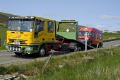 FINSTOWN ORKNEY Roadside recovery lorry picking up broken down Royal Mail van Picture Credit: Doug Houghton / Scottish Viewpoint Tel: +44 (0) 131 622 7174   Fax: +44 (0) 131 622 7175 E-Mail : info@sco... Public break,down,service,roadside,recovery,lorry,vehicle,scotland,scottish,mechanic,road,thoroughfare,mechanical,breakdown,industry,lorries,transport,car,motor,motorcar,automobile,traditional,local,traditio