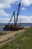 Crockness HOY ORKNEY Rusting crane barge used to salvage Scapa sunken naval vessels Picture Credit: Doug Houghton / Scottish Viewpoint Tel: +44 (0) 131 622 7174   Fax: +44 (0) 131 622 7175 E-Mail : in... Public orkney,hoy,crockness,scotland,scottish,destruction,disintegration,remains,rusting,metal,structure,damage,damaged,decayed,machine,winch,maritime,rusty,wreckage,salvage,salvaging,recover,recovering,scra