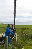 Low impact tracked post driver hydraulic post drive fencing post  FARMING ORKNEY Picture Credit: Doug Houghton / Scottish Viewpoint Tel: +44 (0) 131 622 7174   Fax: +44 (0) 131 622 7175 E-Mail : info@... Public field,fence,post,driver,fencing,barbwire,posts,low,impact,tracked,hydraulic,drive,farming,orkney,rural,economy,farm,rustic,farms,fenced,barrier,wire,posting,pole,tractors,machines,vehicles,tractor,mac