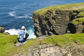 North coast seacliffs birdwatcher with binoculars watching Fulmars  BIRSAY ORKNEY Picture Credit: Doug Houghton / Scottish Viewpoint Tel: +44 (0) 131 622 7174   Fax: +44 (0) 131 622 7175 E-Mail : info... Public bird,watching,scotland,coast,uk,birdwatcher,north,seacliffs,binoculars,fulmars,birsay,orkney,watcher,sea,cliffs,line,birds,watchers,looking,look,search,survey,searching,surveying,observing,overlooking