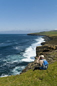 North coast seacliffs birdwatcher with binoculars look out to sea  BIRSAY ORKNEY Picture Credit: Doug Houghton / Scottish Viewpoint Tel: +44 (0) 131 622 7174   Fax: +44 (0) 131 622 7175 E-Mail : info@... Public bird,watcher,watching,scotland,birdwatcher,uk,sea,cliffs,north,coast,seacliffs,with,binoculars,look,out,to,birsay,orkney,line,birds,watchers,people,man,male,one,adult,person,men,males,adults,coastline