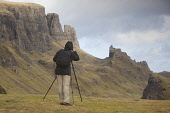 Photographer working at The Quiraing, Isle of Skye, Inner Hebrides, Scotland. Picture Credit : Peter Cairns / Scottish Viewpoint Tel: +44 (0) 131 622 7174   Fax: +44 (0) 131 622 7175 E-Mail : info@sco... Public October,Peter Cairns,Scotland,Skye,The Quiraing,autumn,health,hobby,human,man,outdoors,person,photographer,recreation,rock formations,upland,working