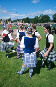 Competitors in the Highland Dancing Competition at a Scottish Highland Games. Picture Credit : Jason Baxter / Scottish Viewpoint Tel: +44 (0) 131 622 7174   Fax: +44 (0) 131 622 7175 E-Mail : info@sco... Public summer,sunny,dancer,dancers,event,compete,competing,tradition,traditional,cultural,tourism,kilt,tartan