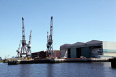 A boat trip on the River Clyde passes the BAE Systems shipyard, west of the city centre of Glasgow. Picture Credit : Iain McLean / Scottish Viewpoint Tel: +44 (0) 131 622 7174   Fax: +44 (0) 131 622 7... Public 2011,summer,sunny,building,industry,engineering engineers,crane,cranes