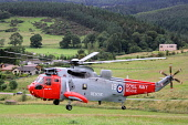 Royal Navy Search and Rescue Helicopter on excercise from HMS Gannet in the Tweed Valley near Glentress, Scottish Borders. Picture Credit : Jason Baxter / Scottish Viewpoint Tel: +44 (0) 131 622 7174... Public summer,chopper,hover,hovering,landing,fly,flying,heli,assistance,help,999,flight,aircraft,emergency,services,service