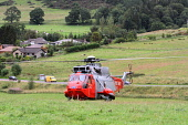 Royal Navy Search and Rescue Helicopter on excercise from HMS Gannet in the Tweed Valley near Glentress, Scottish Borders. Picture Credit : Jason Baxter / Scottish Viewpoint Tel: +44 (0) 131 622 7174... Public summer,chopper,heli,assistance,help,999,flight,aircraft,emergency,services,service