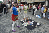 Fringe performers promote their shows on Edinburgh's Royal Mile, during the Edinburgh Fringe Festival. Picture Credit : Andrew Wilson / Scottish Viewpoint Tel: +44 (0) 131 622 7174   E-Mail : info@sco... Public, NMR 2011,summer,event,actor,actors,art,arts,old,town,costume,costumes,show,promotion,people,high,street