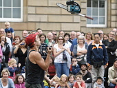A street performer on the Edinburgh's Royal Mile, during the Edinburgh Fringe Festival. Picture Credit : Andrew Wilson / Scottish Viewpoint Tel: +44 (0) 131 622 7174   E-Mail : info@scottishviewpoint.... Public, NMR 2011,summer,event,art,arts,old,town,juggle,juggler,chainsaw,people,high,street