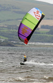 A competitor taking part in the 2nd Kiteival kitesurfing festival at Ayr - the competition is also the 5th round of the British Kitesurfing Association's championships. Picture Credit : Garry McHarg /... Public, NMR 2011,autumn,event,compete,kitesurfer,kite,surfing,surfer,coast,coastal,water,firth,clyde,seafront,BKSA,championship