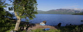 Looking across Loch Ness from Dores, Highland Region. Picture Credit : D Barnes / Scottish Viewpoint Tel: +44 (0) 131 622 7174   E-Mail : info@scottishviewpoint.com This photograph cannot be used with... Public 2011,summer,sunny,water,boat,hill,hills,panoramic