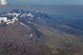 Aonach Mor on the south side of Glen Spean, with Ben Nevis visible beyond, Highlands of Scotland. The Nevis Range Mountain Resort is located on the northern slopes of the peak visible bottom right. Pi... Public 2009,summer,sunny,aerial,highland,hill,hills,mountain,mountains,munro,snow