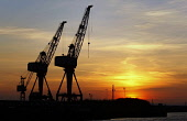 Sunset over the River Clyde, west of the city centre of Glasgow. Picture Credit : Garry McHarg / Scottish Viewpoint Tel: +44 (0) 131 622 7174   E-Mail : info@scottishviewpoint.com This photograph cann... Public 2011,silhouette,atmospheric,crane,cranes,industry,ship,building,shipbuilding