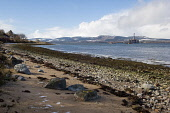 The shoreline of the Cromarty Firth at Balblair on the Black Isle, Highland. Picture Credit : Ross Graham / Scottish Viewpoint Tel: +44 (0) 131 622 7174   E-Mail : info@scottishviewpoint.com This phot... Public 2011,oil,rig,petrochemical,winter,coast,coastal,beach,sand,shingle,sunny,industry,water