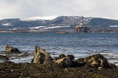 Looking over the Cromarty Firth from the Black Isle to an oil rig at Invergordon, Highland. Picture Credit : Ross Graham / Scottish Viewpoint Tel: +44 (0) 131 622 7174   E-Mail : info@scottishviewpoin... Public 2011,winter,snow,petrochemical,coast,coastal,industry,water