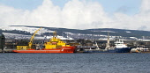Ships docked at Inverngordon on the Cromarty Firth, viewed from Balblair on the Black Isle, Highland. Picture Credit : Ross Graham / Scottish Viewpoint Tel: +44 (0) 131 622 7174   E-Mail : info@scotti... Public 2011,winter,snow,petrochemical,coast,coastal,industry,water