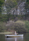 Angler in a boat, fishing for trout on Lindean Reservoir near Selkirk, Scottish Borders. Picture Credit : Derek Mitchell / Scottish Viewpoint Tel: +44 (0) 131 622 7174   E-Mail : info@scottishviewpoin... Public 2011,spring,activity,fishermen,fly,cast,casting,line