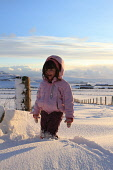 Young girl walking through snowdrifts, Mainland, Orkney.Picture Credit : Mark Ferguson / Scottish ViewpointTel: +44 (0) 131 622 7174  E-Mail : info@scottishviewpoint.comThis photograph cannot be used... Public, MR 2010,winter,sunny,child,infant,joy,excitement,rural,snowscape,blue,sky,snow,snowfall,snowy,snowscene, child, children, snowy, girls, kid, kids