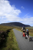Cycling the coast road to Moaness, Island of Hoy, Orkney.Picture Credit : Mark Ferguson / Scottish ViewpointTel: +44 (0) 131 622 7174  E-Mail : info@scottishviewpoint.comThis photograph cannot be used... Public 2011,summer,sunny,active,activity,adult,bicycle,bike,child,cycle,dad,enjoy,exercise,family,father,fit,fun,helmet,kid,leisure,male,man,parent,people,recreation,ride,sport,isle,island,Hoy,Moaness,cyclin
