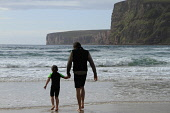 Paddling at the sheltered Rackwick Beach, Island of Hoy, Orkney.Picture Credit : Mark Ferguson / Scottish ViewpointTel: +44 (0) 131 622 7174  E-Mail : info@scottishviewpoint.comThis photograph cannot... Public 2011,summer,sunny,beach,sand,sandy,child,childhood,dad,daughter,family,healthy,holiday,joy,kid,leisure,lifestyle,people,play,playing,water,wave,waves,cliff,paddle,bay,isles,islands, children, family,