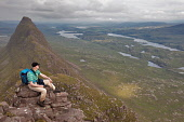 A hillwalker on Suilven looking towards Cam Loch, Assynt, Highlands of Scotland. Picture Credit : Peter Scott / Scottish Viewpoint Tel: +44 (0) 131 622 7174   E-Mail : info@scottishviewpoint.com This... Public 2009,summer,sutherland,inverpolly,national,nature,reserve,NNR,lochan,water,walking,hillwalking,hill,walker,hiker,climber,climbing