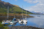 Yachts and boats moored at a small jetty on Loch Leven, with the Ballachulish Bridge visible beyond, Highlands of Scotland. Picture Credit : Dennis Barnes / Scottish Viewpoint   Tel: +44 (0) 131 622 7... Public 2012,spring,sunny,sailing,activity,boat,yacht,boating,reflections,hills,mountains,highland,reflection,water