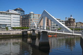 The Tradeston Bridge also known as the Squiggly Bridge over the River Clyde, Glasgow. Picture Credit : Dennis Barnes / Scottish Viewpoint   Tel: +44 (0) 131 622 7174  E-Mail : info@scottishviewpoint.c... Public 2012,summer,sunny,pedestrian,footbridge,walkway,financial,finance,district,structure,engineering,people,city